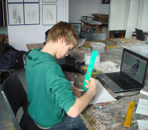 A Year 8 pupil building a new skyscraper prototype